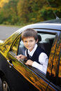 Schoolboy into the car Stock Image