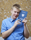 Schoolboy with the certificate about completion of education at school upset from parting Royalty Free Stock Images