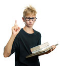 Schoolboy clever holding a books Royalty Free Stock Photography