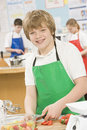 Schoolboy in a cooking class Stock Photos