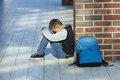 Schoolboy crying in the hallway of the school Royalty Free Stock Photo