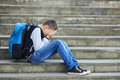 Schoolboy crying on the street Royalty Free Stock Photo