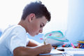 Schoolboy doing homework at home Stock Images
