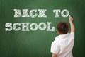 Schoolboy drawing on blackboard, education concept Royalty Free Stock Photo