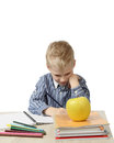Schoolboy with focus on apple Royalty Free Stock Photo