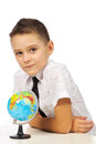 Schoolboy with a globe isolated in studio Stock Photos