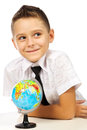 Schoolboy with a globe isolated in studio Stock Photo