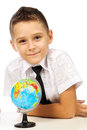 Schoolboy with a globe isolated in studio Royalty Free Stock Photo