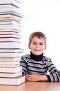 Schoolboy and a heap of books isolated on white background Stock Images