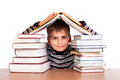 Schoolboy and a heap of books isolated on white background Royalty Free Stock Images