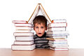 Schoolboy and a heap of books on white background Stock Photos