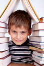 Schoolboy and a heap of books on white background Stock Image