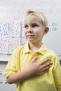 Schoolboy With His Hand Over Heart Stock Photography