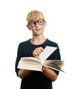 Schoolboy inattentive with a book Royalty Free Stock Photo