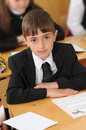 The schoolboy at a lesson at school. Stock Photo