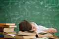 Schoolboy lying and sleeping on book Royalty Free Stock Photo