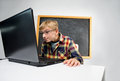 Schoolboy with notebook diligent sits at the Royalty Free Stock Image