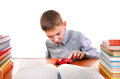 Schoolboy plays with a toy on the school desk on the white background Royalty Free Stock Photos