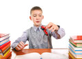 Schoolboy plays with a toy on the school desk on the white background Royalty Free Stock Images