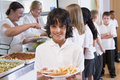 Schoolboy in a school cafeteria Royalty Free Stock Image