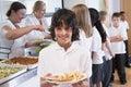 Schoolboy in a school cafeteria Royalty Free Stock Photo