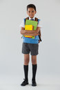 Schoolboy in school uniform with school bag on white background Royalty Free Stock Photo