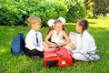 Schoolboy and schoolgirls in the park portrait of Stock Photography