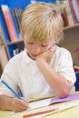 A schoolboy sitting in a primary class Royalty Free Stock Photo
