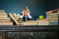 Schoolboy in stress or depression at school classroom Royalty Free Stock Photo