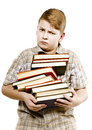 Schoolboy teenager studying holding tutorials books Royalty Free Stock Photo