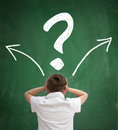 Schoolboy thinking with question marks overhead