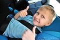 Schoolboy using child safety seat
