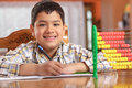 Schoolboy writing homework and has a smile on his face Stock Photo