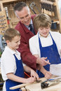 Schoolboys and teacher in woodwork class Stock Photography