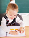 Schoolchild in classroom near blackboard. Stock Photos
