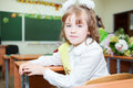 Schoolchild sitting at the desk in classroom Stock Images