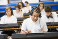Schoolchildren on keyboards in music class Royalty Free Stock Image