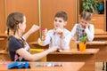 Schoolchildren at lesson school kids work Stock Images