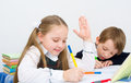 Schoolchildren little writing in workbook Stock Photos
