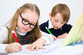 Schoolchildren little writing in workbook Royalty Free Stock Image