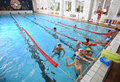 Schoolchildren swim in the covered sports public swimming pool russian federation saint petersburg october photo illustration for Royalty Free Stock Image
