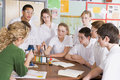 Schoolchildren and teacher in science class Stock Photo