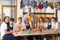 Schoolchildren and teacher sitting around a table Royalty Free Stock Image