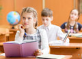 Schoolchildren work at lesson school kids in classroom Royalty Free Stock Images