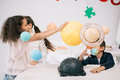 Schoolchildren working with solar system model in classroom Royalty Free Stock Photo