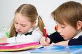 Schoolchildren writing in workbook little Royalty Free Stock Photo