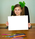 Schoolgirl artist with white blank paper sheet Stock Photos