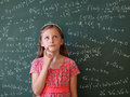 Schoolgirl and blackboard with mathematical formulas Royalty Free Stock Photography