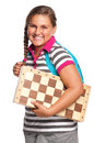 Schoolgirl with chessboard Stock Images