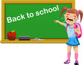 Schoolgirl crying for back to school illustration featuring a little and pointing at written on blackboard isolated on white Stock Photo